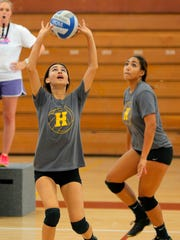 Hartnell College freshman Geneve Hernandez sets the ball during volleyball practice on campus Wednesday.