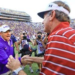LSU Tigers head coach Les Miles and South Carolina Gamecocks head coach Steve Spurrier meet following a game at Tiger Stadium. LSU defeated South Carolina 45-24.