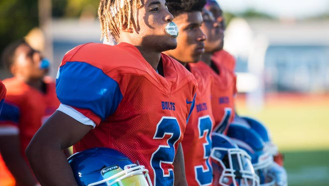 Millville wide reciever Marcial Ramos (2) stands for the anthem before playing Kingsway at John Barbose Stadium in Millville on Friday, September 15.