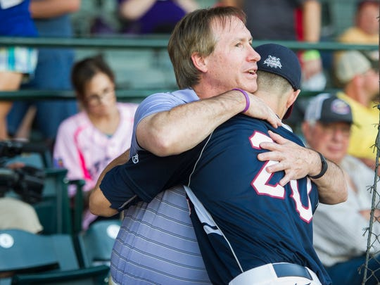 Chris Sweeney, of Mountain Top, Pa., hugs his son, Evansville centerfielder Chris Sweeney before game five of the 2016 Frontier League Championship Series at Bosse Field in Evansville, Monday, Sept. 19, 2016.