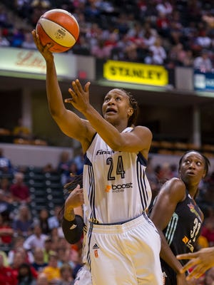 Indiana Fever forward Tamika Catchings (24) goes up the basket to score during the first half of a WNBA Eastern Conference Finals game, Sunday, September 27, 2015, at Bankers Life Fieldhouse in Indianapolis.