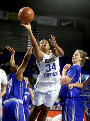 MTSU's Olivia Jones (34) goes up for a shot between Coastal Georgia's Kaci Palo (10) and Anissa Toumi (34), on  Wednesday, Nov. 4, 2015.
