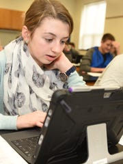 Grace Eby, 14, a student in teacher Tara Clopper's environmental science class, uses a Surface laptop computer to take a test Thursday, Feb. 4, 2016 at Greencastle-Antrim High School. The school is getting ready to implement their new technology plan for next spring.