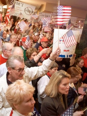 Hundreds of Oklahomans show their support Monday, March 3, 2003, for America's troops by attending a rally at a local mall.