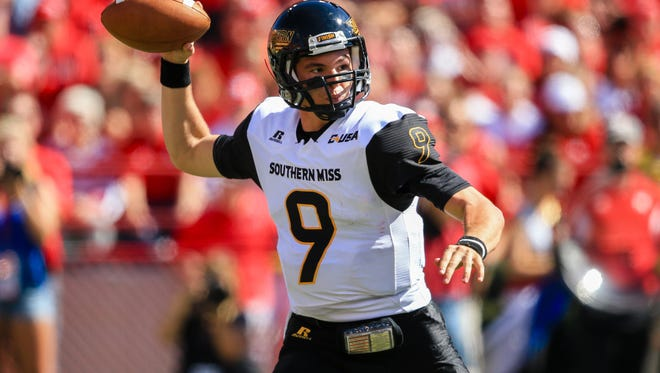 Southern Miss quarterback Nick Mullens (9) continues rise through the school's record books.