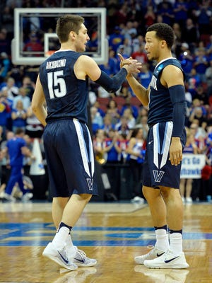 Villanova Wildcats guard Ryan Arcidiacono (15) and guard Jalen Brunson (1) before the game against the Kansas Jayhawks in the south regional final of the NCAA Tournament at KFC YUM!