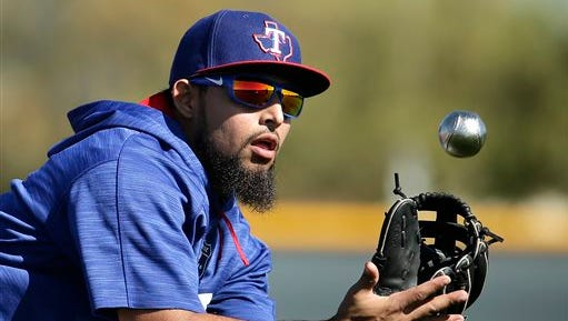 Texas Rangers' Rougned Odor catches a ball during spring training baseball practice Sunday.