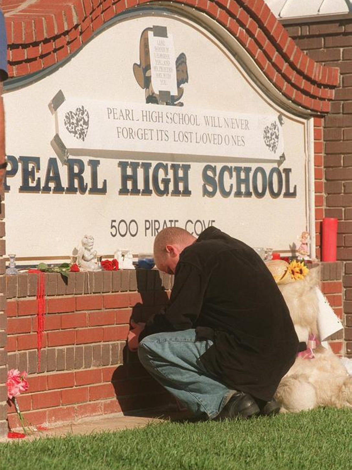 A Pearl High School student prays for fellow students who were injured and killed Oct. 1, 1997, during a shooting at the school.