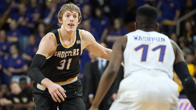 Wichita State Shockers guard Ron Baker (31) brings the ball up court as Northern Iowa Panthers guard Wes Washpun (11) defends during the first half at McLeod Center.