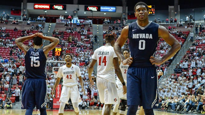 Wolf Pack forward Cameron Oliver (0) and guard D.J. Fenner (15) and San Diego State Aztecs guard Jeremy Hemsley (42) react during the second half at Viejas Arena on Sunday.