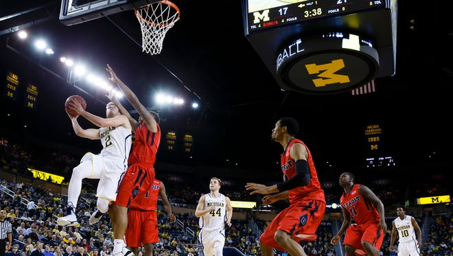 Michigan Wolverines guard Spike Albrecht (2) goes to the basket in the first half against the Detroit Titans at Crisler Center.
