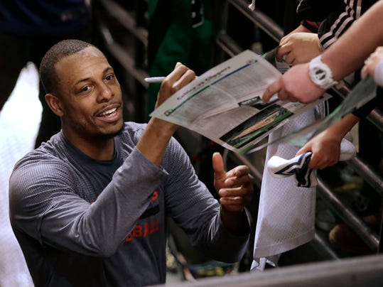 Los Angeles Clippers forward Paul Pierce, left, signs autographs for fans before an NBA basketball game against the Boston Celtics, Sunday, Feb. 5, 2017, in Boston. Pierce, a former Boston Celtics player, is to play in what is expected to be his final game in Boston Sunday, Feb. 5. (AP Photo/Steven Senne)
