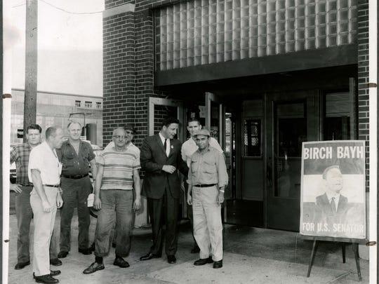 Senator Birch Bayh talking to workers outside the Warner Gear plant in Muncie in 1962.
