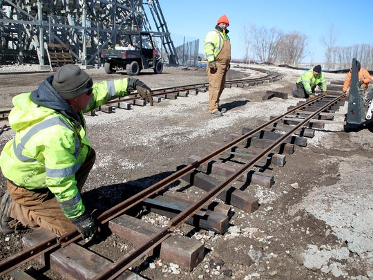 Green Bay Parks and Recreation Department workers have been busy laying down track for a new railroad at Bay Beach Amusement Park that will travel  behind and pass under  the Zippin Pippin roller coaster.