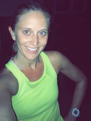 Katherine Warner, a 31-year-old runner from Lake Orion, has entered the international half marathon.