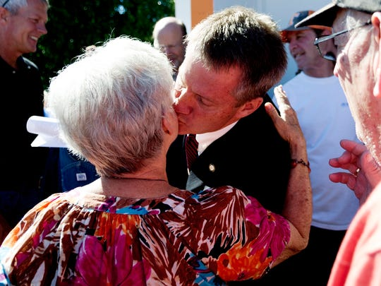 Knox County Mayor Tim Burchett kisses a supporter on the cheek after announcing his candidacy for Congress during a ceremony at Vol Market #3 on Western Avenue in Knoxville on Aug. 5, 2017.