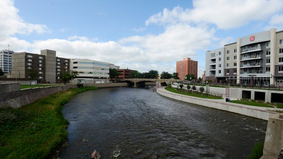The Big Sioux River is seen Friday as it winds through downtown Sioux Falls. A new book tells the story of how South Dakota's eastern border almost followed the river through Sioux Falls. That would have put part of downtown in South Dakota and part in Minnesota.