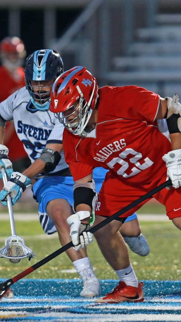 Suffern's Mikey Ryan (27) and North Rockland's Jack Guerra (22) battle for control of the ball during boys lacrosse game at Suffern Middle School on May 8, 2018. Suffern defeated North Rockland 21-13.