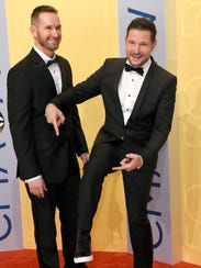 Ty Herndon, right, shows off his shoes as Matt Collum