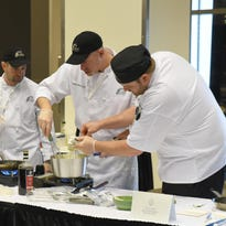 Chef Darren Wendell and his team prepare their three-course meal.