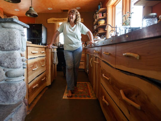 Susan Walch stands kitchen of her all natural home