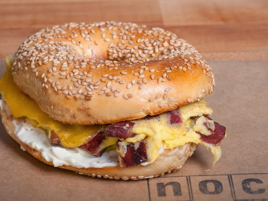 The Pastrami & Egg Sandwich features housemade pastrami, Gruyere and cream cheese on an H&H bagel.