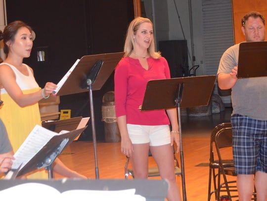 Rachel Moon, Lydia Gray and Andrew Jamison, standing,