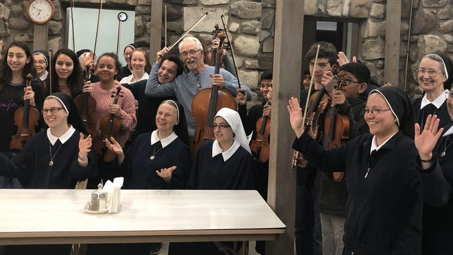 Marycrest Sisters with Allegro members having a little fun after the concert on Dec. 12.