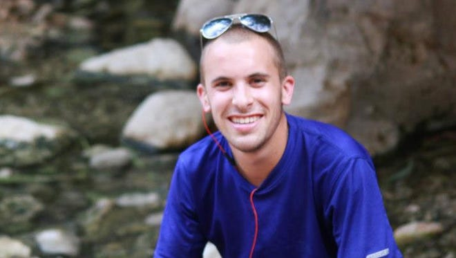 Max Steinberg poses on a trip to Israel in 2012. Stuart Steinberg confirmed the death of his son on Sunday.