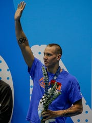 Caeleb Dressel waves to the crowd after his first place finish in the 50-meter freestyle race at the Phillips 66 National Championships at IUPUI Natatorium in Indianapolis on Saturday, July 1, 2017.