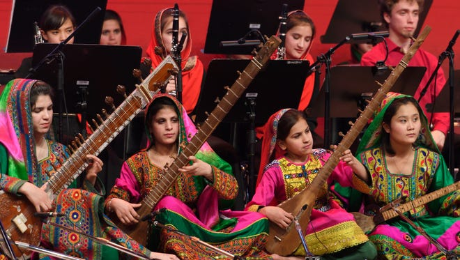 Afghanistan's first all-female orchestra performs during the closing ceremony of the World Economic Forum on January 20,2017 in Davos.