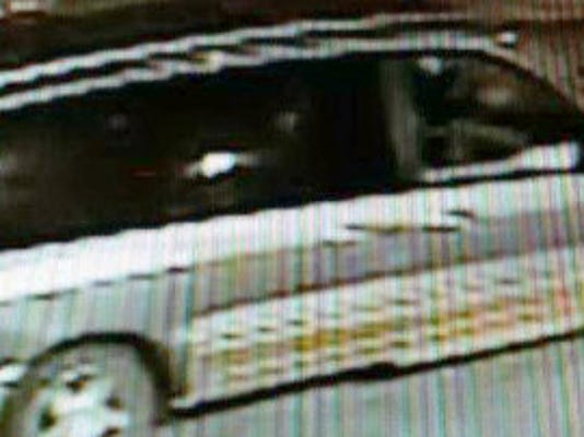 The van that police say the armed robbery suspect had been seen driving.