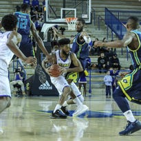 Blue Hens give UNCW a test but fall 91-81