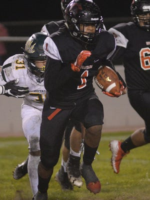 Rio Mesa's Dominic McLaughlin escapes from Royal High's Aiden Carillo during the first half of a Division 8 first-round playoff game Friday night at Rio Mesa High. The Spartans won 41-7.