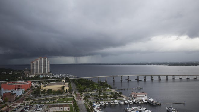 A storm lets loose over the Caloosahatchee River on Monday. Photographed from the top of the former Amtel Marina and Hotel.