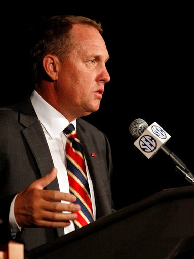 Mississippi coach Hugh Freeze speaks to the media at the Southeastern Conference NCAA college football media days, Thursday, July 17, 2014, in Hoover, Ala. (AP Photo/Butch Dill)