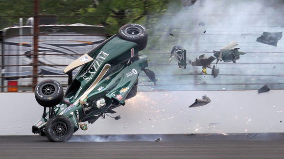 Ed Carpenter (20) of CHF Racing hits the wall coming out of turn 2 and goes airborne during the morning practice on Pole Day for the Indianapolis 500 Sunday, May 17, 2015, at the Indianapolis Motor Speedway.