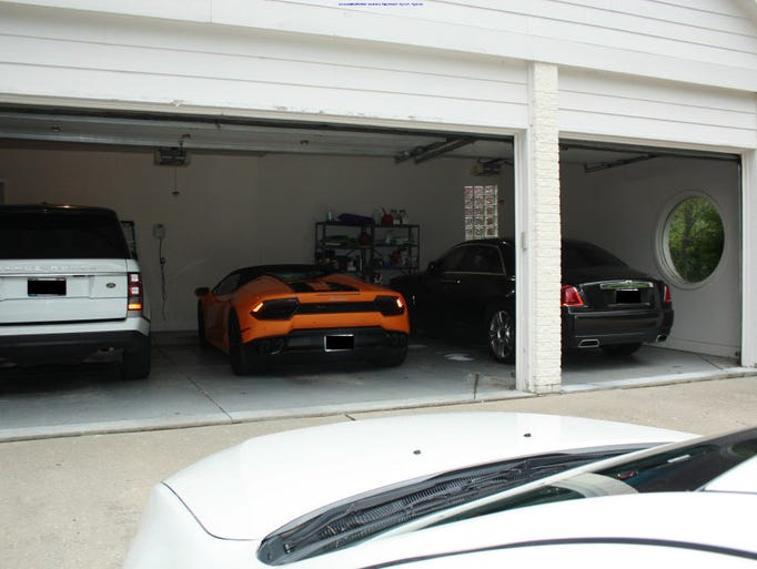 fbi photos show cars tons of cash in massive fraud case. Black Bedroom Furniture Sets. Home Design Ideas