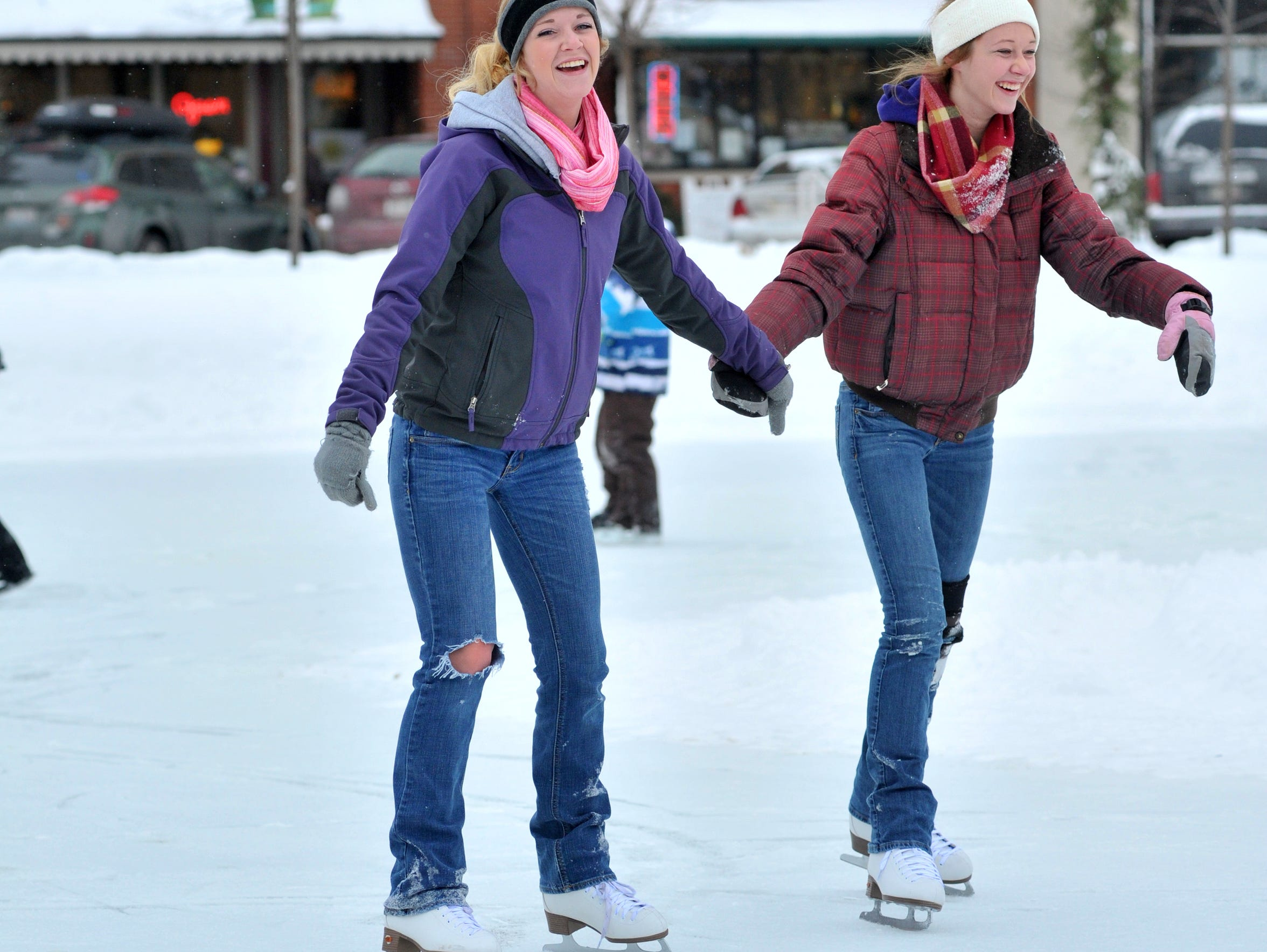Kennedy Bianco, left, and her sister Amber, skate at