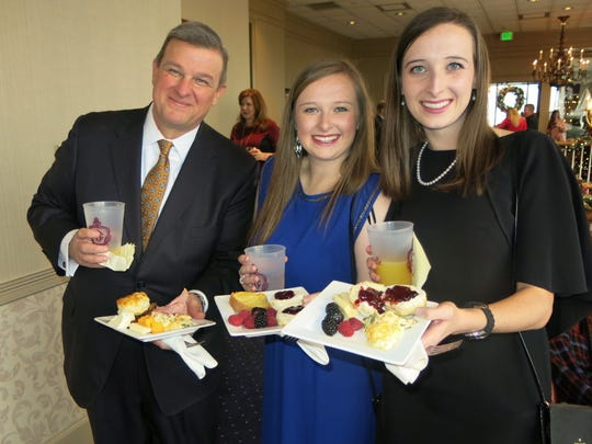 Roy Prestwood and former Demoiselle Debs Rachel Lee and Courney Prestwood finding a seat for brunch at the Jazz Brunch.