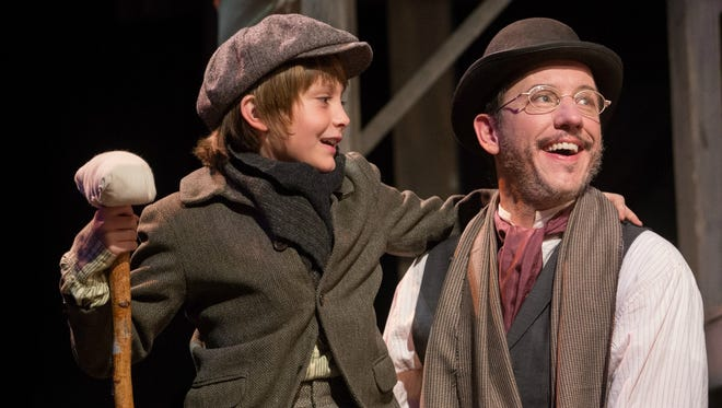 "Mason Rothermel as Tiny Tim and Gary Clemmer as Bob Cratchit reprise their roles from last year's critically-acclaimed production of ""Charles Dickens' A Christmas Carol."""