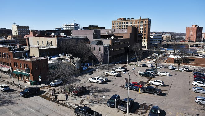 The parking lot along 10th Street behind PAve Thursday, March, 24, 2016, in downtown Sioux Falls. The location was supposed to be the site of a multi-million dollar mixed-use facility, but rising construction costs derailed the project.