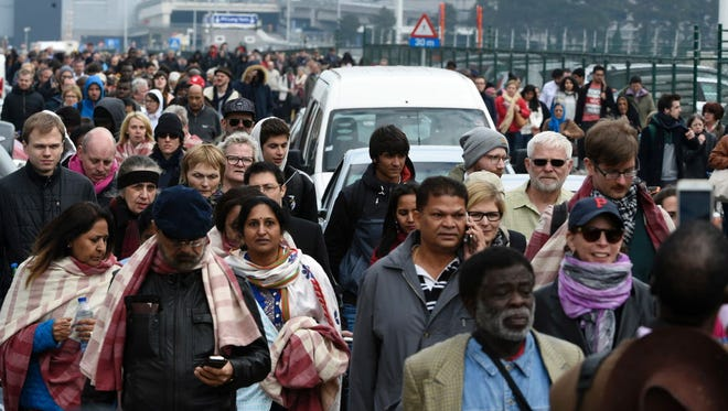 Passengers are evacuated from Brussels airport on March 22, 2016.