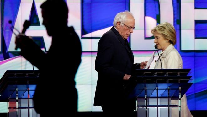 Bernie Sanders and Hillary Clinton at the CNN Democratic Presidential Primary Debate in Brooklyn on April 14, 2016.
