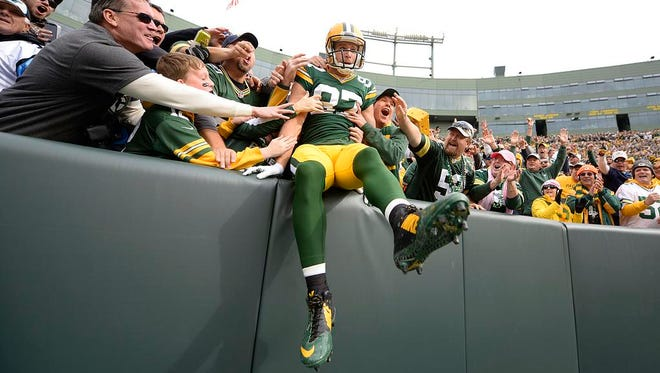 Green Bay Packers wide receiver Jordy Nelson does a Lambeau Leap after scoring a touchdown against the Carolina Panthers during the first quarter of Sunday's game at Lambeau Field.