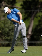 Jordan Spieth watches hits a tee shot on the second