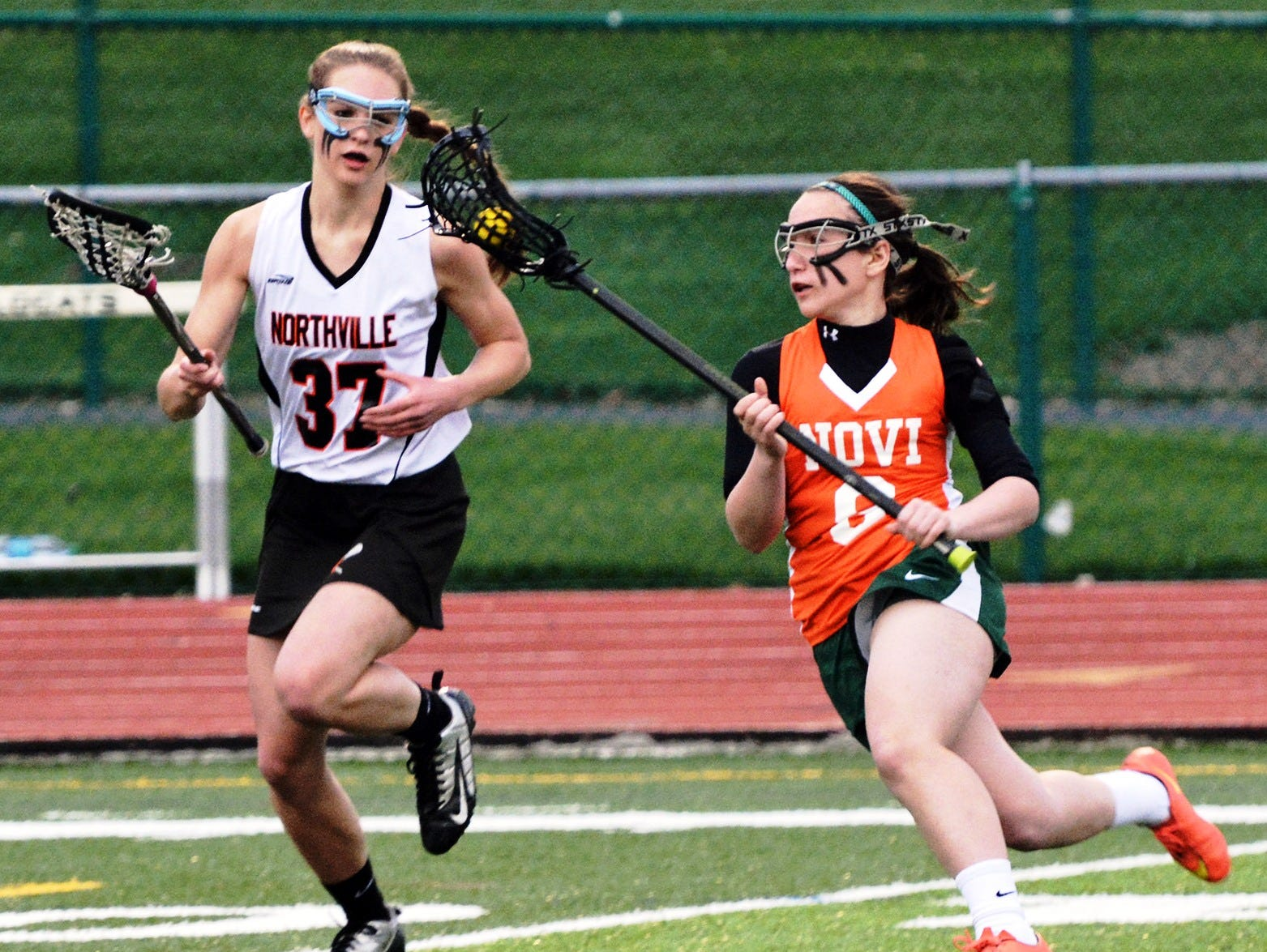 Novi's Gina Salemi (right) goes on the attack against Northville's Shayla Croteau.