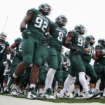 Michigan State enters the stadium prior to a game against the Purdue Boilermakers at Spartan Stadium.