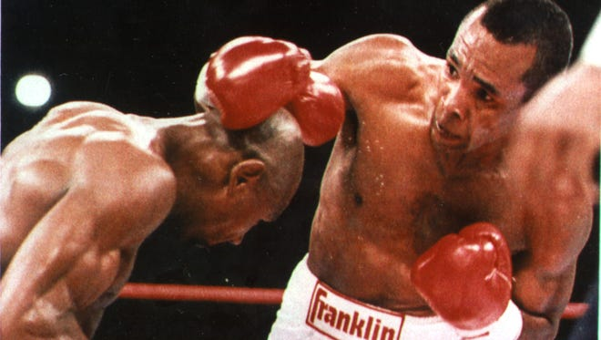 Sugar Ray Leonard throws a right over the top of Marvelous Marvin Hagler during the the second round of their middleweight title fight in Las Vegas on April 6, 1987