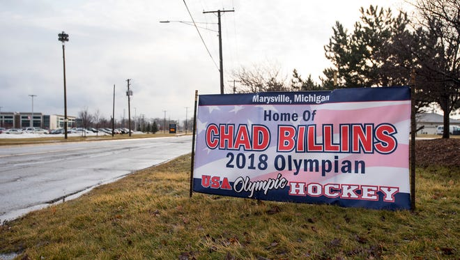 A banner in honor of Chad Billins sits on the side of Huron Avenue, across from Marysville High School. Marysville native Chad Billins was chosen to play on Team USA hockey in the 2018 Winter Olympics.